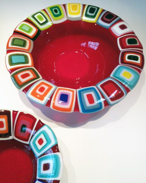 Glass bowls: Red. 40 and 30 cm in diameter. By the danish designer and artist Louise Lagoni.