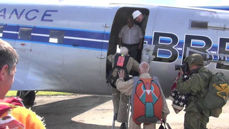"Jim ""Pee Wee"" Martin did a (tandem) jump behind Utah Beach with the Round Canopy Parachuting Team."