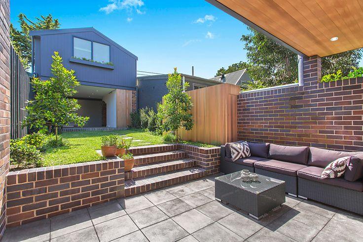 Hardscape outside house (where existing concrete slab is), rebuild retaining wall for mezzanine garden