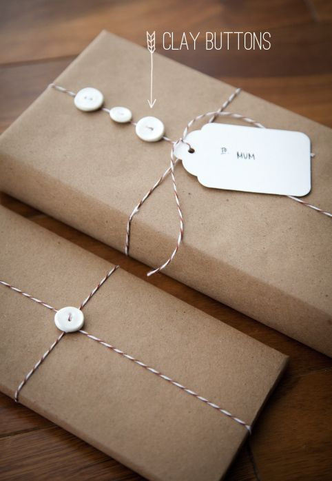 handmade clay buttons for gift packaging // boxwood clippings