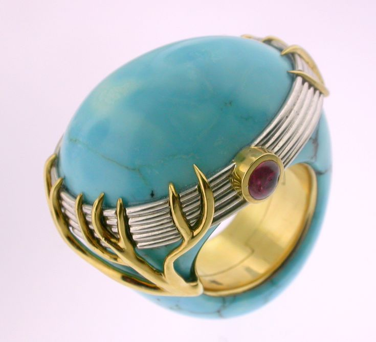 RING TURQUOISE: white and yellow gold, 2 rubis 0,40 ct. 16OS0007