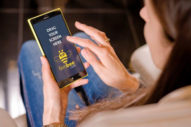 Woman using Nokia Lumia #Phone #Nokia #woman # freelance # freelancer # home # app # lumia # nokia lumia # mobile #