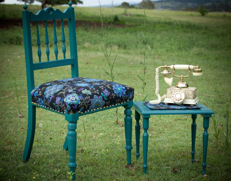 This Chair has been reupholstered in a modern floral print with gold highlights. Both chair and side table have been painted in peacock green with a high gloss finish. See Nine Stitches on Facebook for more pictures... https://www.facebook.com/pages/Nine-Stitches/1395225480724976