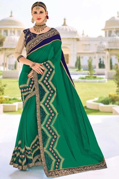 Embroidered Georgette Teal Saree with Lace Border