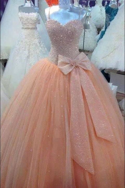 #Amazing beaded peach ball #gown #prom #dress for special evening party. Bodice is covered  with #shimmering beads, side waist is decorated with pretty bow, puffy tulle skirt cascades. Back is lace up.
