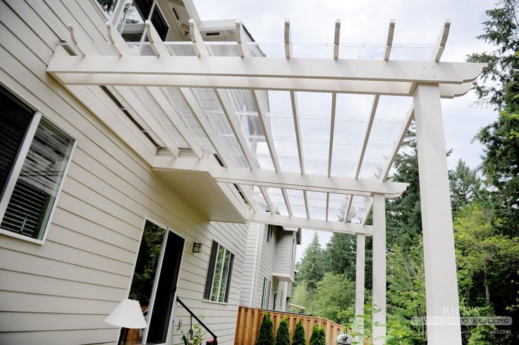 Vinyl Pergola & Vinyl Pergola Kits | Rick's Custom Fencing & Decking - I like these clear panels for the pergola over the door. Looks easier to clean that the corrugated that we have now.