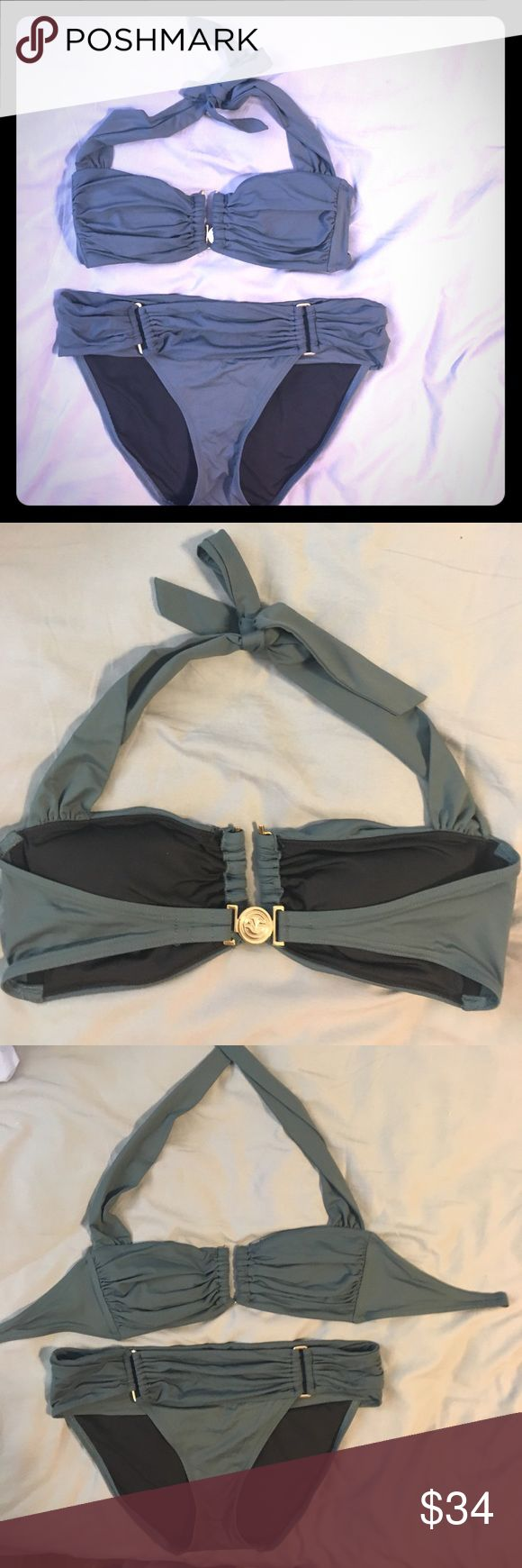 Victoria's Secret bikini size large Army green. Gold hardware with VS logo, bandeau top with tie around neck, each piece is size large tags  have been cut out for comfort, good condition mostly kept in storage, only worn two or three times Victoria's Secret Swim Bikinis