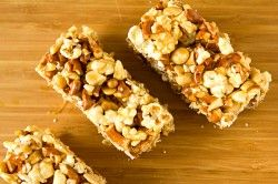 Salted Caramel Popcorn Pretzel bars   (-peanuts+salted sunflower seeds w/dark chocolate drizzle on top?)