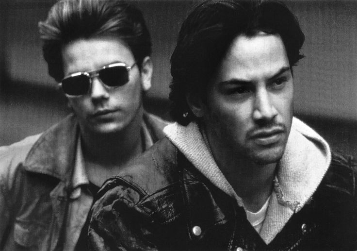 https://flic.kr/p/PLALm7 | Keanu Reeves and River Phoenix in My Own Private Idahoe (1991) | French postcard, no. 1035. Photo: publicity still for My Own Private Idahoe (Gus Van Sant, 1991).  Keanu Reeves (1964) is a Canadian actor, producer, director and musician. Though Reeves often faced criticism for his deadpan delivery and perceived limited range as an actor, he nonetheless took on roles in a variety of genres, doing everything from introspective art-house fare to action-packed…