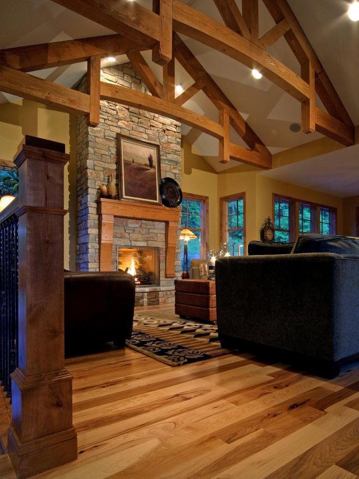 This rustic living room has beamed and vaulted ceilings