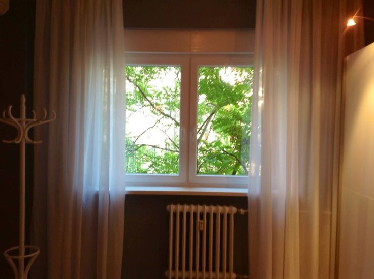 View from bedroom 1. The window opens to a quiet inner garden of the house, green and calm.