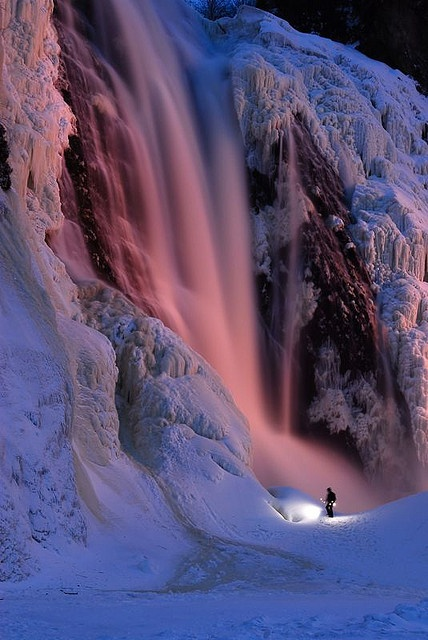 Frozen Montmorency Falls, Quebec, Canada. During winter the water freezes and some people climb the frozen waterfall.