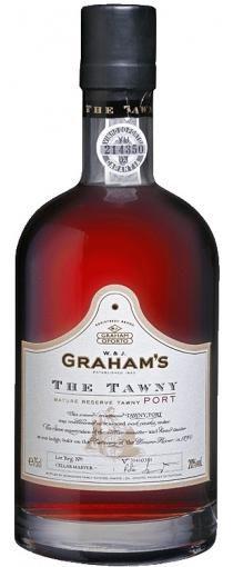 """Graham's The Tawny: Prachtige Port met een licht aroma van geroosterde amandelen en kaneel. De kleur is diep amber goud. De smaak is rijk met een lange afdronk, maar """"The Tawny"""" heeft tevens een stevig karakter met een evenwichtige zuurgraad en zachte tannines. """"It's what's in the Barrel that counts !"""" 7 jaar Houtrijping."""