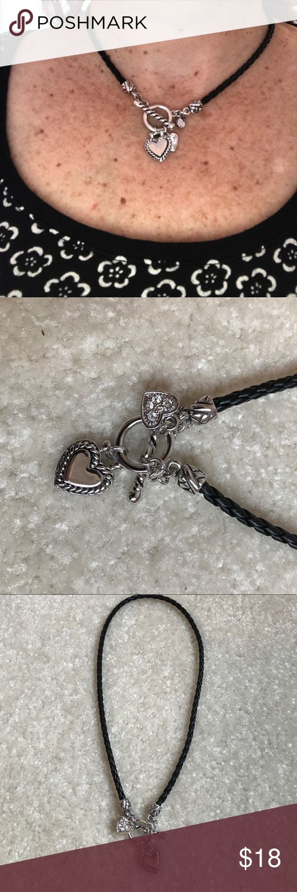 """Lia Sophia charm necklace Lia Sophia charm necklace on braided leather-like chain. 16"""" long. Comes with box. Lia Sophia Jewelry Necklaces"""