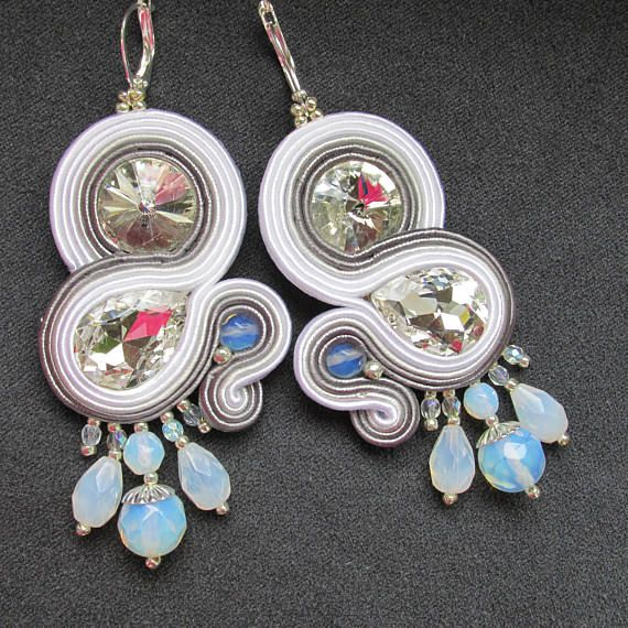 Hello!  I present handmade dangle earrings.  Those earrings are made of soutache in white and gray color. You will find here silver toho beads, natural milk opal beads and beautiful shiny silver almond-shaped crystals. Each earring is decorated with a colorful bead cascade. Bottom of earring