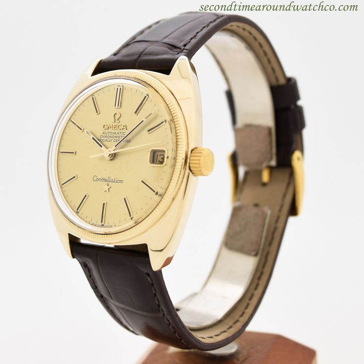 A 1969 Omega Constellation Ref. 168.027. This 14K yellow gold timepiece features an awesome, tonneau-shaped case, with a champagne dial and date function.