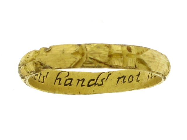 Engraved posy ring, 'Absence parts' hands' not hearts', English, early 17th century. A yellow gold band, the exterior engraved with repeating crowned hearts, the interior with the inscription 'Absence parts' hands' not hearts', and stamped with an English maker's mark, approximately 2.57g in weight.
