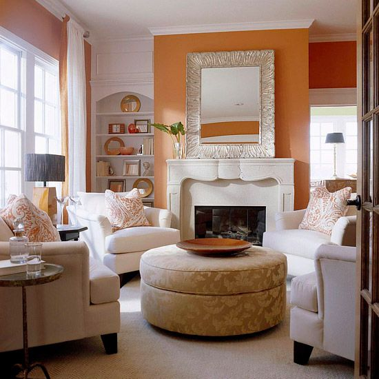If your space is too small for a couch, opt for several overstuffed chairs instead. The smaller pieces add comfy seating and take up less space. The chairs form a cozy conversation circle.