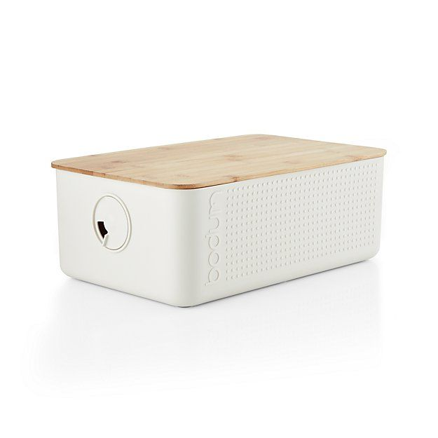 A tried and true method of keeping bread fresh, this sleek-looking bread box has a crumb-catching bamboo lid that doubles as a serving tray. Large capacity accommodates oversized loaves.