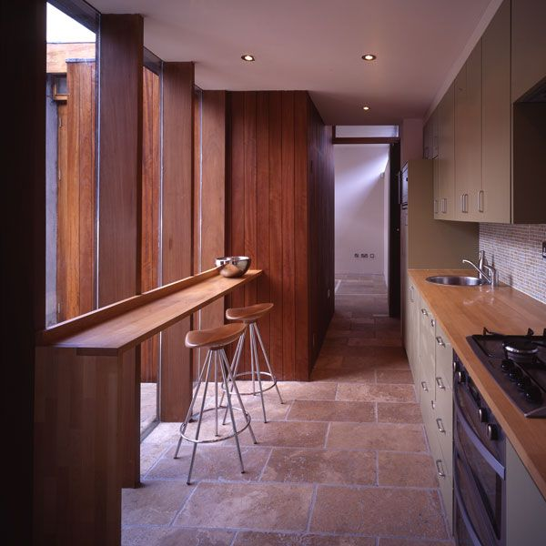 This is manifest by the bathroom box with the kitchen gathered under, spanning from the existing house to the new utility block which is placed at the node of the cruciform.