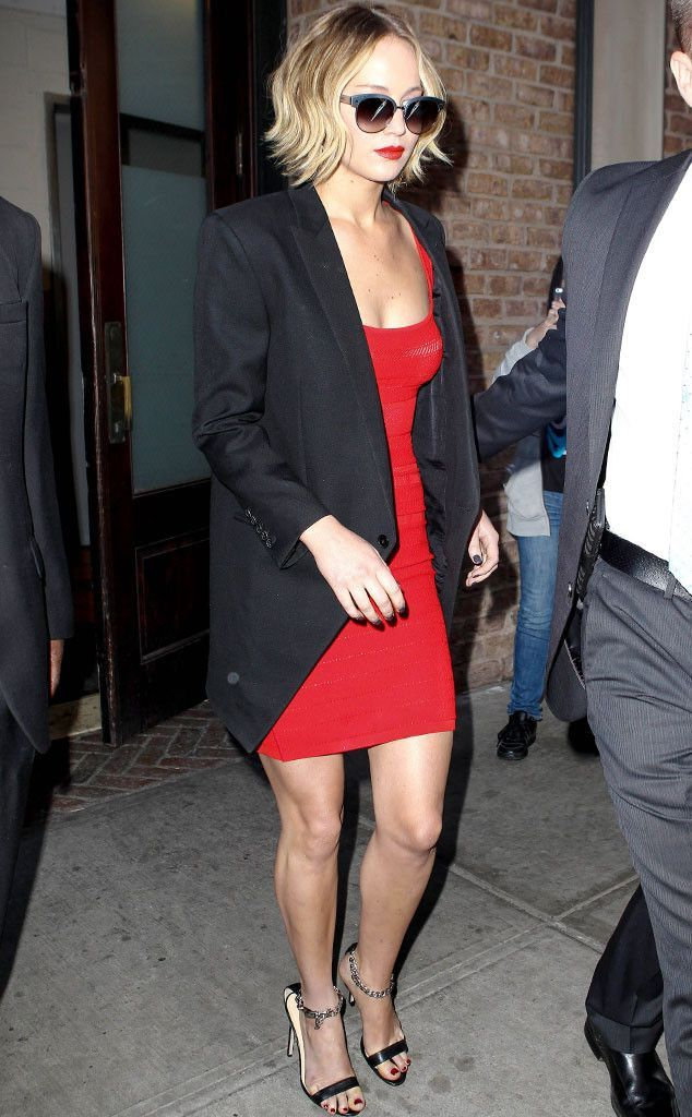 J-Law looking incredible in a classic little red dress, smartened up with a black blazer, killer heels and diva-style sunglasses! The perfect date night outfit!