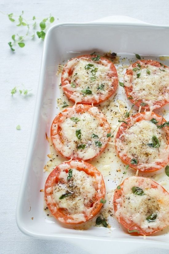 Parmesan Baked Tomatoes. Yum! Place 2 medium sliced tomatoes on a baking sheet, sprinkle with 1/3cup of Parmesan, oregano, salt, pepper, and drizzle with olive oil. Bake at 450 for 10-15 minutes.