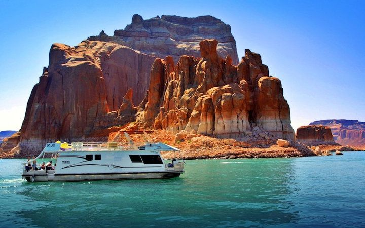 Lake Powell: Utah/Arizona  Desert Houseboating: Take a houseboat cruise through the red-rock desert wilderness. Created by Glen Canyon Dam in northern Arizona, the vast lake stretches for nearly 200 miles into uninhabited southern Utah and includes more than 80 side canyons where yours will often be the only boat.