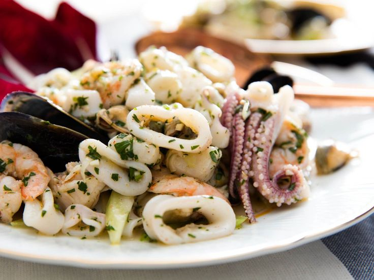 Italy's classic light, bright salad of gently cooked and marinated seafood, including shrimp, squid, scallops, and mussels, with lemon juice, olive oil, parsley, and subtle spices.