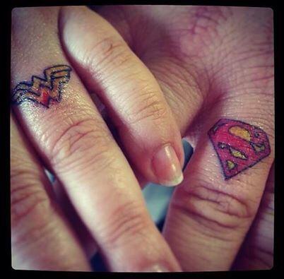 Couple tattoos, superman and wonder woman