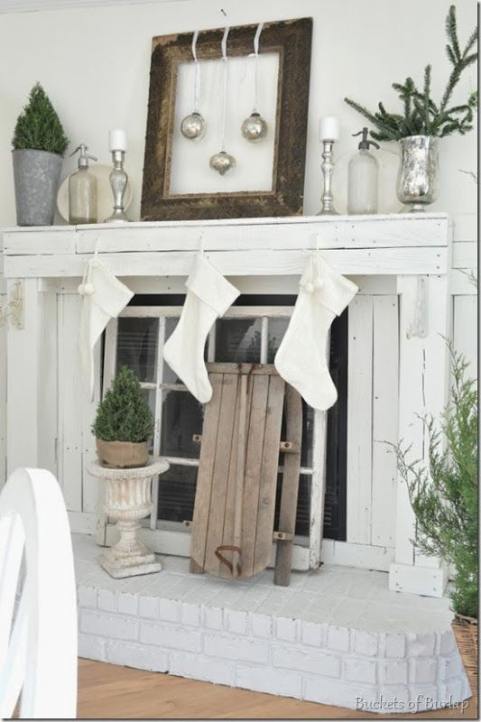 Farmhouse Christmas mantle - I like the idea of the window in the fireplace! Unique!