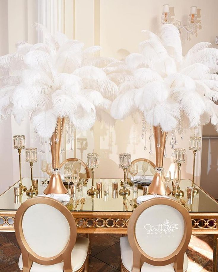 Feathers are a great way to forgo #flowers and introduce a little old Hollywood glamour. Great design @nolaeventplanners!  @southernamore #munacoterie #munaluchibride