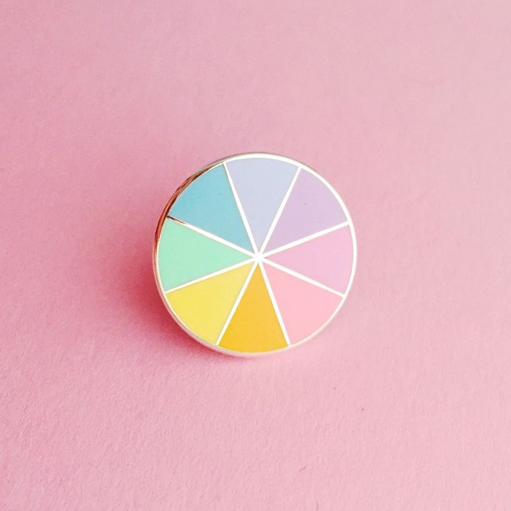 This little pin packs a pastel punch, featuring 8 different hard enamel colours in a rainbow colour wheel! Bring a little rainbow wherever you go.Pin measures 1.9cm in diameter and has a rubber clutch back. Listing is for 1 Pastel Colourwheel Pin - other pins featured can be found in my shop.