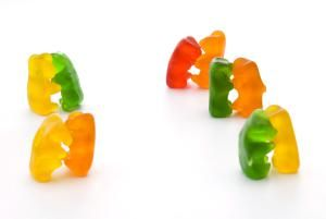 In the chemical reaction, the Gummi (Gummy) Bears dance in a flame, not with each other. - Glow Images, Getty Images