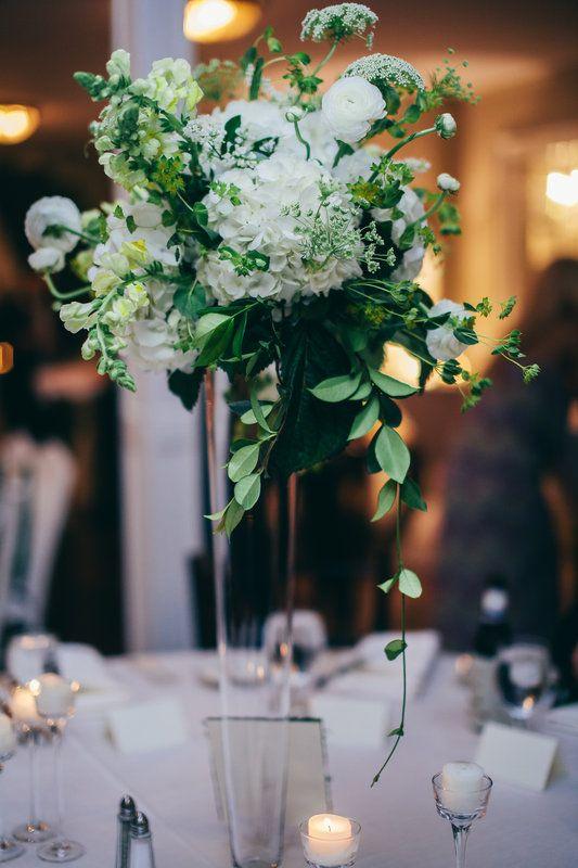 Tall arrangement on clear glass trumpet vase of crisp