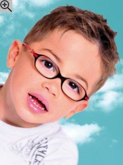 Modern haircut for boys who wear glasses. A short textured cut to style in many different ways.