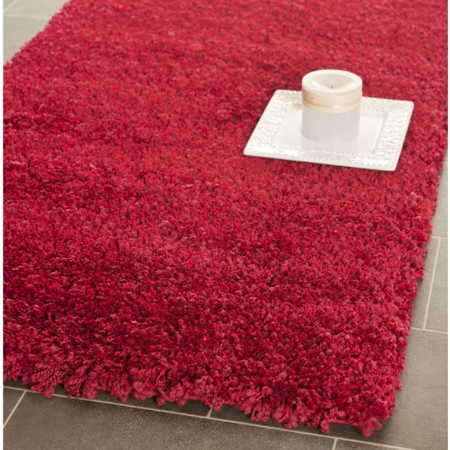 treat your toes to the cozy warmth of this red shag area rug this rug