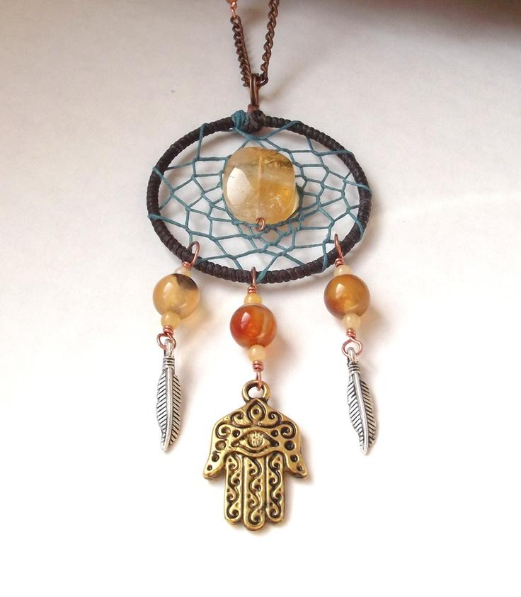 Dreamcatcher necklace with hamsa hand/hand of fatima and gemstones. $32.00, via Etsy.