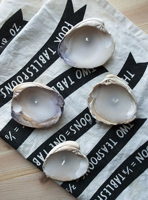 shell candles...tea lights and shells...lovely little lights...
