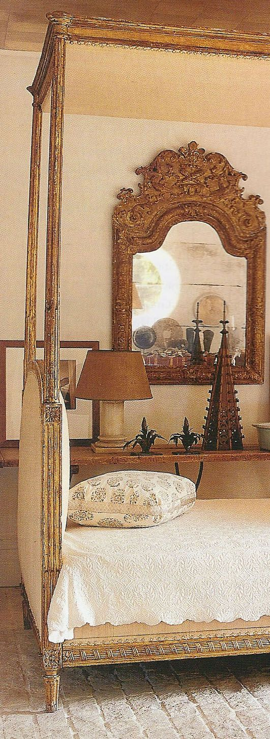 Mirror in a Mediterranean style old world bedroom.  Great colors and textures.