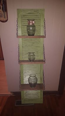 Moss green antiqued with pallet wood shelves. Plastic shutter.