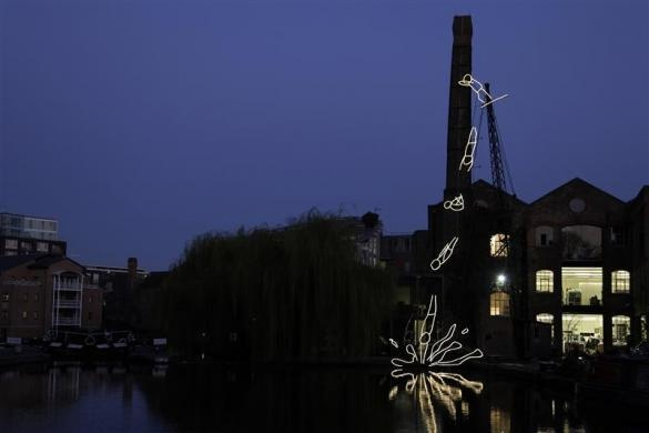 The animated light sculpture 'Diver' by artist Ron Haselden is seen on the side of the Regents Canal in Angel, north London March 21, 2012. REUTERS/Stefan Wermuth