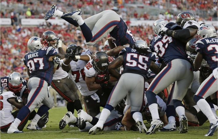 The start of the NFL football betting action comes as a schocker for many as Dallas Cowboys beat NY Giants. Review NFL preseason games again and check out which teams really do well. Check out this photo of Tampa Bay Buccaneers' Doug Martin scores a touchdown on their first drive against the New England Patriots during their NFL preseason football game.  Visit: http://www.sportsbook.ag/football-betting/NFL/