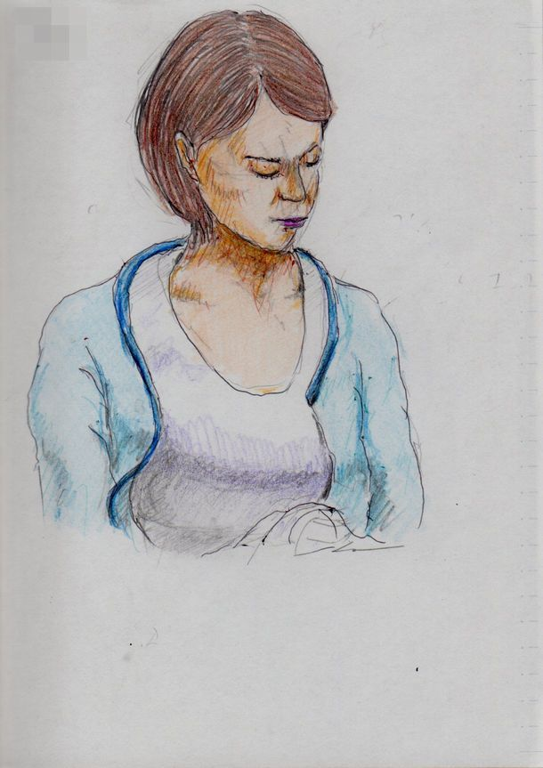 It is a sketch of a woman wearing a light blue cardigan.  I drew on the train going to work.