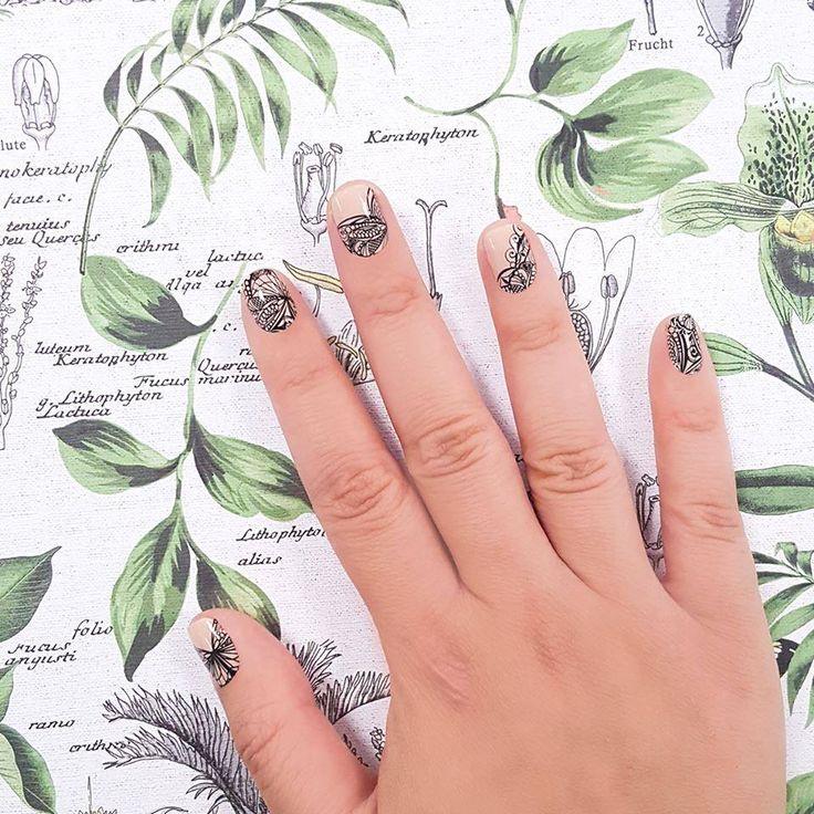 """""""Butterfly Garden"""" features a a subtle yet bold butterfly wing pattern over pale beige - an elegant, grownup take on butterfly nails! #nailart"""