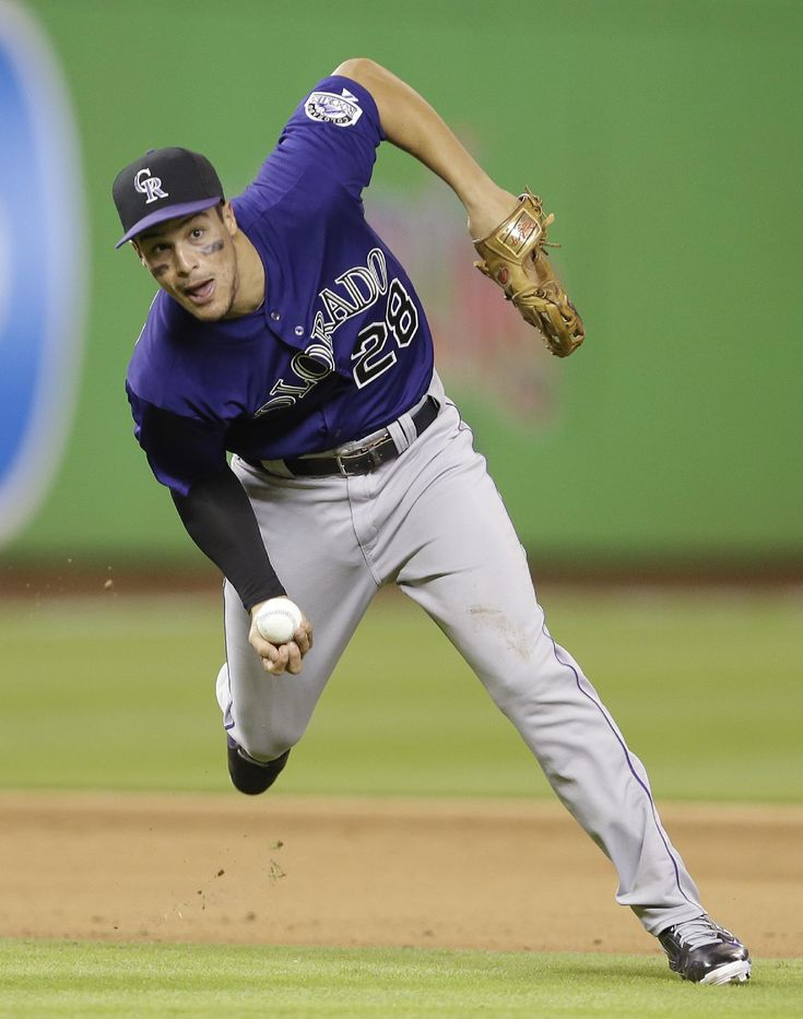 Colorado Rockies third baseman Nolan Arenado throws late to first base in the fifth inning during the inning of an opening day baseball game, Monday, March 31, 2014, in Miami. (AP Photo/Lynne Sladky)