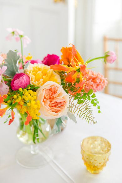 Peach, Yellow, Coral, Orange + Bright Pink Floral Arrangements | Colorful Charleston Garden Wedding at the Gadsden House by Charleston wedding photographer Dana Cubbage