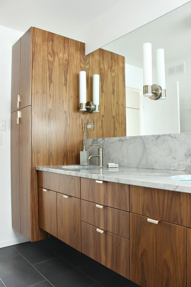 AYA kitchens walnut cabinetry in modern bathroom reno - linen tower and vanity both installed to be floating for a contemporary look