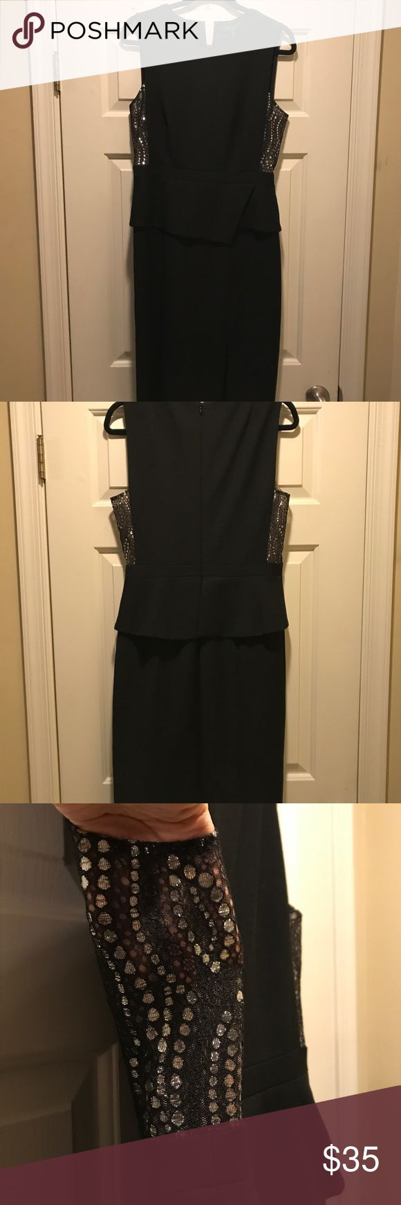 BCBG black peplum dress BCBG black peplum dress. This dress is stunning with sparkle lace on the sides that is slightly see through. Worn once. Size 8 but could fit a 10 depending on your size. BCBG Dresses Midi