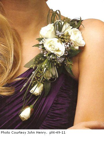 Bridal corsages can be worn by the bride, but these beautiful designs would also be appropriate for any mother of the bride, grandmothers, prom or homecoming dance.This delightful spray is made with one stem of white spray roses.  Spray roses open quickly, so reserve some tight buds and keep them in the refrigerator to mix in the the other open roses.  Loops of bear grass, Italian Ruscus and seeded eucalyptus.  Mix in some   flower jewelry     for extra sparkle and shine.