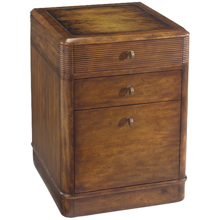 The top drawer is horizontally reeded which continues around the post and along the ends, there is a second drawer below and a file drawer at the bottom. The chamfered molded top has a hand finished d
